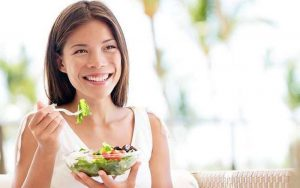 happy woman eating salad