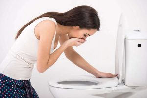 vomiting women in the toilet