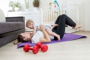 mother working out with a child