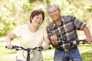 older couple on bikes